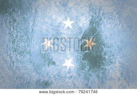 Grunge Micronesia Flag on old paper