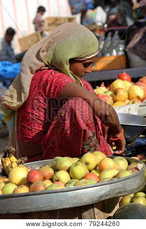 Beautiful Indian Girl Selling Yellow Tomatoes