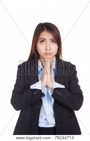 Young Asian Businesswoman Pray With Unhappy Face