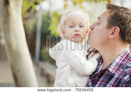 Adorable Little Girl with Her Daddy Portrait Outside.