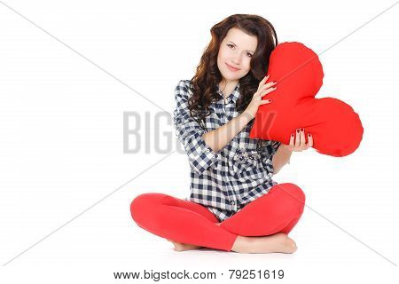 Beautiful gorgeous woman with glamour bright makeup holding red heart isolated on white background.