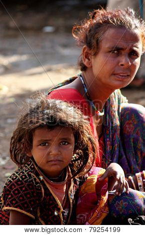 A Poor Indian Mother  With Her Daughter