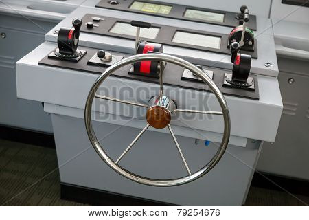 Modern Ship Control Panel With Steering Wheel