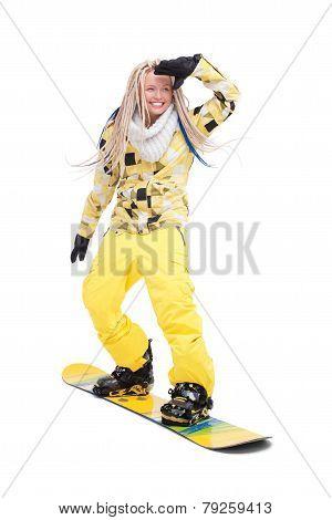 Woman with dreadlocks standing on snowboard