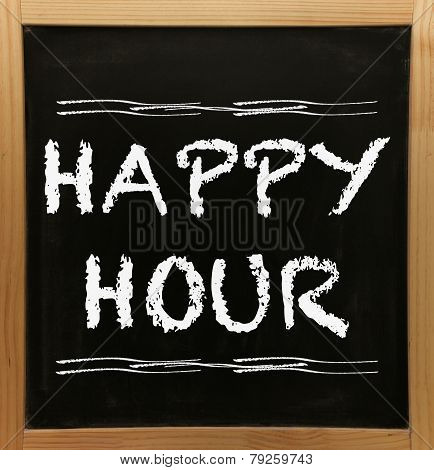 Happy hour sign on chalkboard