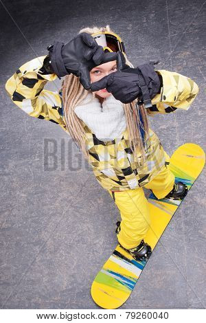 Beautiful woman standing on snowboard