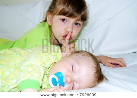 The girl has put the kid to sleep