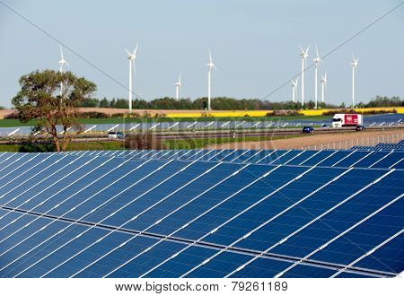 Rape field, solar modules, wind turbines