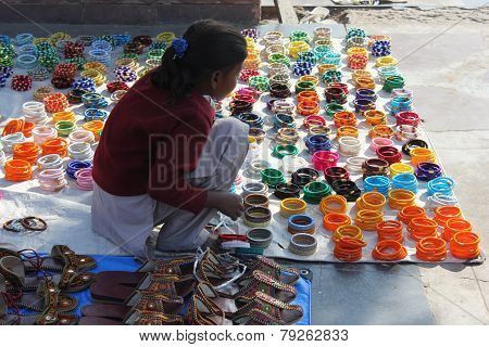 Young Indian Girl Selling Shoes