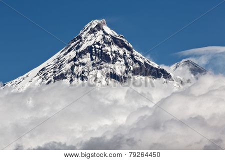 Beautiful Volcanic Landscape: View On Volcano Above Clouds