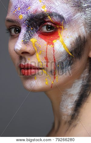 Closeup of model with colorful artistic makeup