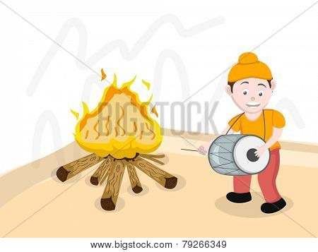 Cute Punjabi boy dancing while playing drum in front of bonfire on occasion of Lohri, Punjabi festival celebration.