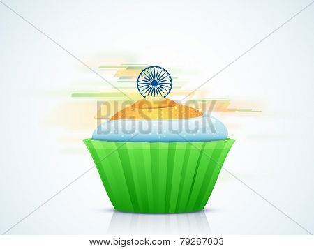 Indian Republic Day celebration with national tricolor cupcake and Ashoka Wheel on abstract background.