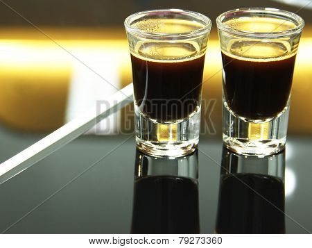 Two Espresso Shots Glass Reflection