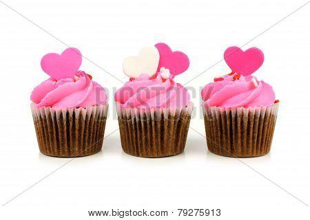 Three pink Valentines Day cupcakes