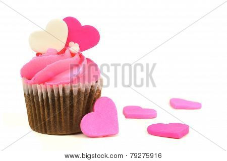 Pink Valentines Day cupcake with candy hearts