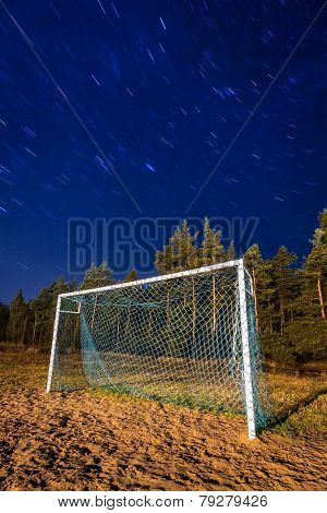 Soccer pitch under starry sky at night