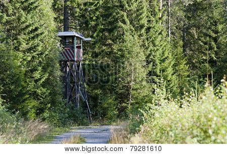 Hunting tower in a forest.