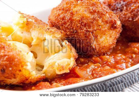 gooey macaroni and cheese balls with marinara sauce