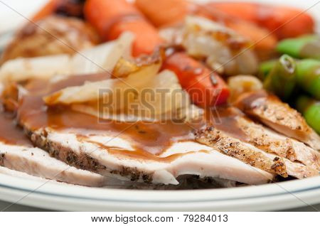traditional turkey dinner with crispy skin, turkey slices and fr