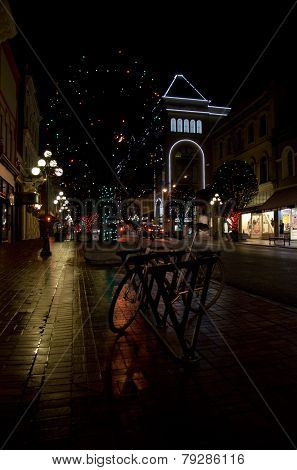 Bicycle Parked On A Night Street With Christmas Decorations