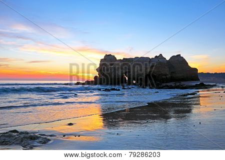 Rock at Praia da Rocha Portimao in the Algarve Portugal at sunset