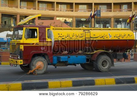 Old tanker truckwith blocking device on wheel