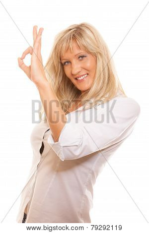 Mature Woman Showing Ok Sign Hand Gesture Isolated