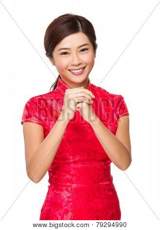 Chinese woman with congratulation hand gesture