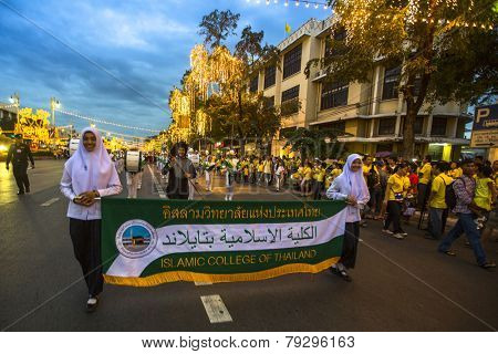 BANGKOK, THAILAND - DEC 05, 2014: Unidentified participants in the celebration of the 87th birthday of Thailand King Bhumibol Adulyadej, is also known as Rama IX, ninth monarch of Chakri Dynasty.