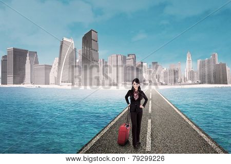 Businesswoman On The Road With Skyscraper Background