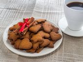 pic of cinnamon  - pepper cinnamon biscuits and a bunch of cinnamon on a white plate - JPG