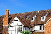 Постер, плакат: Tudor building rooftops Tewkesbury