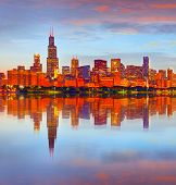 picture of illuminating  - City of Chicago USA at sunset colorful panorama skyline of downtown with illuminated business buildings with reflections - JPG