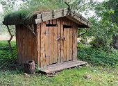 stock photo of outhouse  - Image of an outhouse or outdoor toilet in the country - JPG