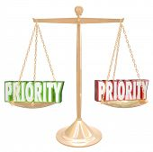 image of priorities  - Priority 3d words on a gold scale or balance to illustrate weighing tasks - JPG