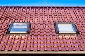 stock photo of gutter  - Tiled Roof with two windows and gutter - JPG