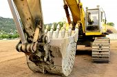 foto of track-hoe  - A large tracked excavator at an construction site - JPG