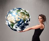 picture of cartographer  - Pretty young girl holding 3d planet earth - JPG