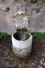 stock photo of spqr  - Ancient drinking water fountain in Rome - JPG