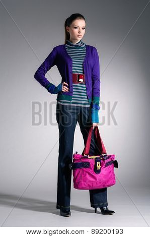 full-length fashion model clothes holding handbag posing