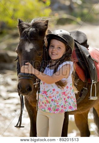 Sweet Beautiful Young Girl 7 Or 8 Years Old Hugging Head Of Little Pony Horse Smiling Happy Wearing