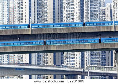 high speed train on bridge in hong kong downtown city at day