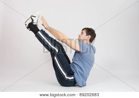 Athlete Stretching His Arms Raised To The Feet