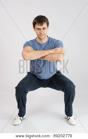 Young Man Performs Squats