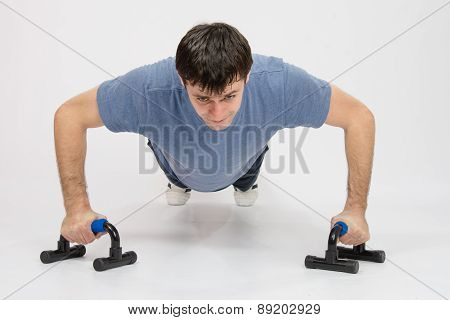 Tired Athlete Is Pushed On Supports