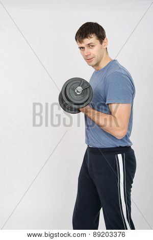 Portrait Of An Athlete With A Dumbbell In Your Left Hand