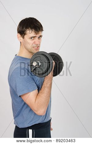 Tired Athlete With Dumbbells