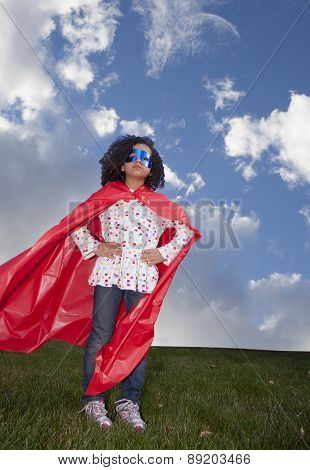 Little Girl Superhero Against Blue Sky