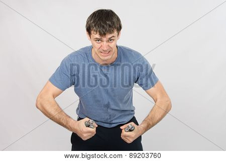 Portrait Of Hard Athlete With Expander